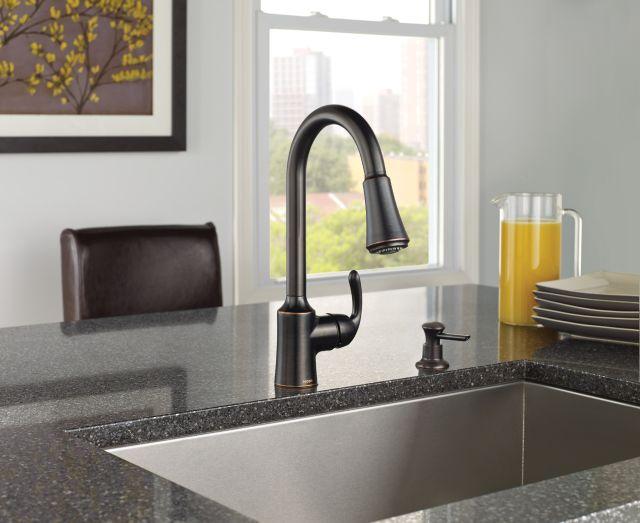 Bayhill™ Mediterranean Bronze one-handle high arc pulldown kitchen faucet.