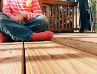 Child playing on a deck