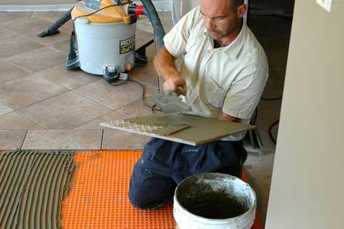 Back Buttering During a Ceramic Tile Flooring Installation